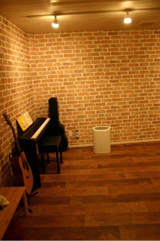 音楽ルームとしても利用している地下室。非日常空間が家にあると、「満足度の高い」家になります