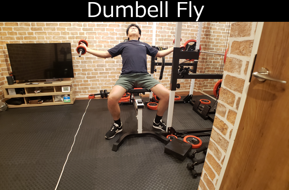 Dumbbell fly at home gym in Japan